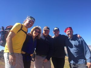 Hiking to the Colorado Governor's Tourism Conference from Aspen to Crested Butte required sunglasses, headwear, jackets and backpacks. Photo courtesy Chris Romer, far left, Vail Valley Partnership.