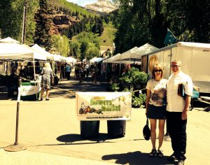 Checking out the Telluride Farmer's Market with a chef from Madeline Hotel & Residences Telluride. Courtesy of Beth Buehler.