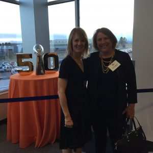 Beth Buehler and Destination Colorado President and Hotel Boulderado General Manager Lisa Lindgren by the Lombardi Trophy.