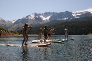 Stand up paddle boarding on Trout Lake. Photo courtesy Telluride Ski Resort/Brett-Schreckengost.