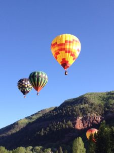 Hot air ballooning in Telluride during a lush green summer. Photo by Beth Buehler.