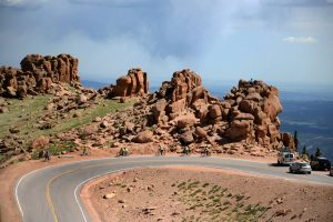 Navigate the twists and turns of the no guardrail Pikes Peak Highway on a bike or in a car. Courtesy VisitCOS.com.