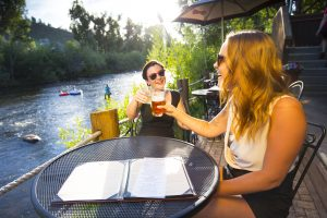 Tubing the Yampa River and taking a break for a beverage in Steamboat Springs. Courtesy Colorado Tourism Office.