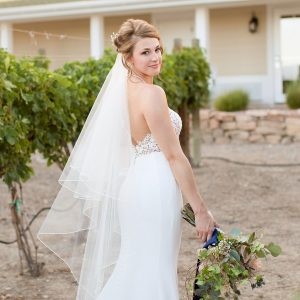A bride among grapevines in Palisade. Courtesy Wine Country Inn.