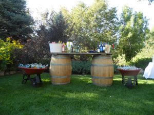 A casual bar setup complete with barrels and wheelbarrows. Courtesy Church Ranch Event Center.