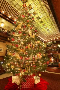 Holiday decorations and the amazing stained glass ceiling in Hotel Boulderado's lobby. Courtesy Hotel Boulderado.
