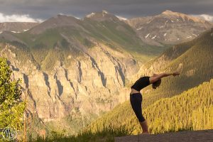 Yoga in Telluride at the top of the free gondola with beautiful mountains as the backdrop.