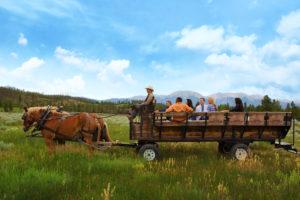 A picturesque wagon ride through a meadow. Courtesy Keystone Resort.