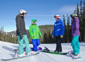 A snowboard lesson on freshly groomed slopes. Courtesy Keystone Resort.