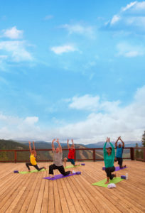 Mountain top yoga with a spectacular view. Courtesy Keystone Resort.