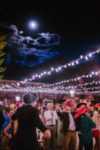 A hat dance under lights, courtesy Realize Colorado.